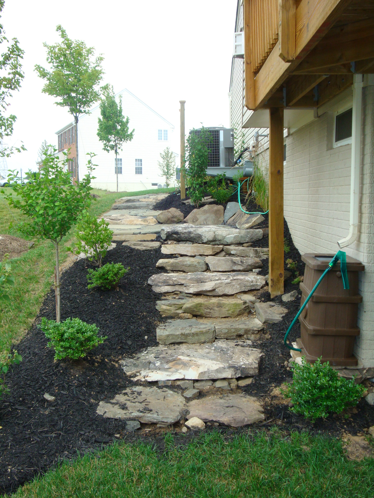 sloping garden design ideas recent installation fieldstone steps revolutionary gardens